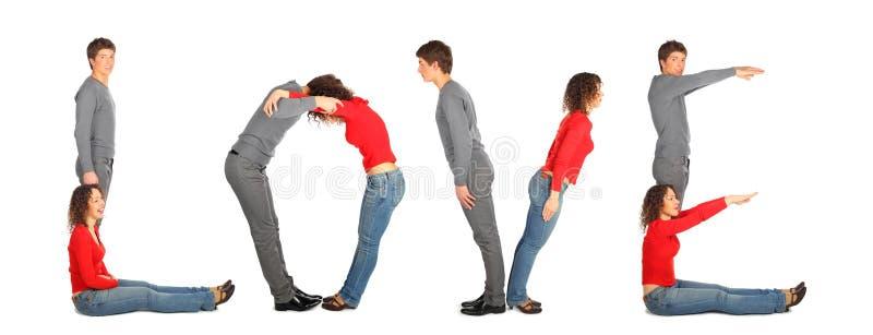 Le jeune homme et le femme effectuant le mot AIMENT, collage image stock