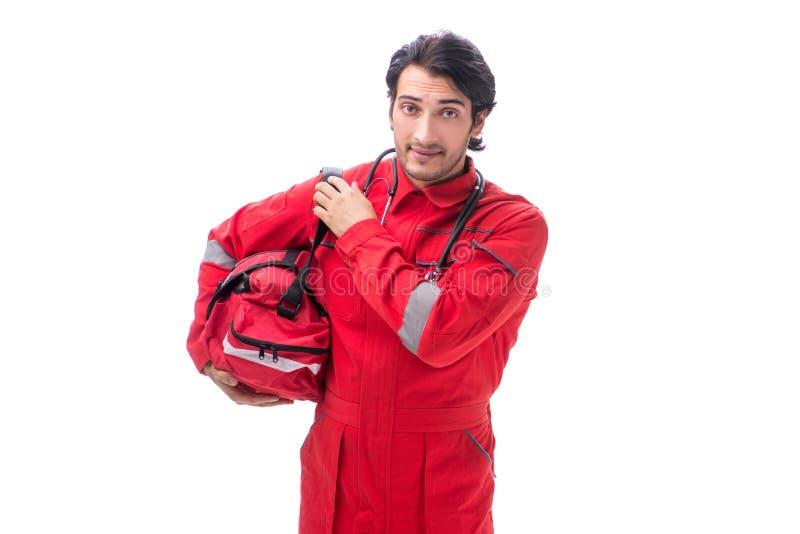 Le jeune infirmier dans l'uniforme rouge d'isolement sur le blanc image libre de droits