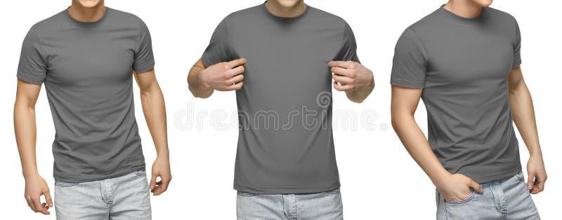 Le jeune mâle dans le T-shirt gris vide, avant et vue arrière, a isolé le fond blanc Concevez le calibre et la maquette de T-shir images libres de droits