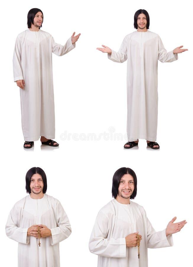 Le jeune prêtre avec la bible d'isolement sur le blanc photos stock