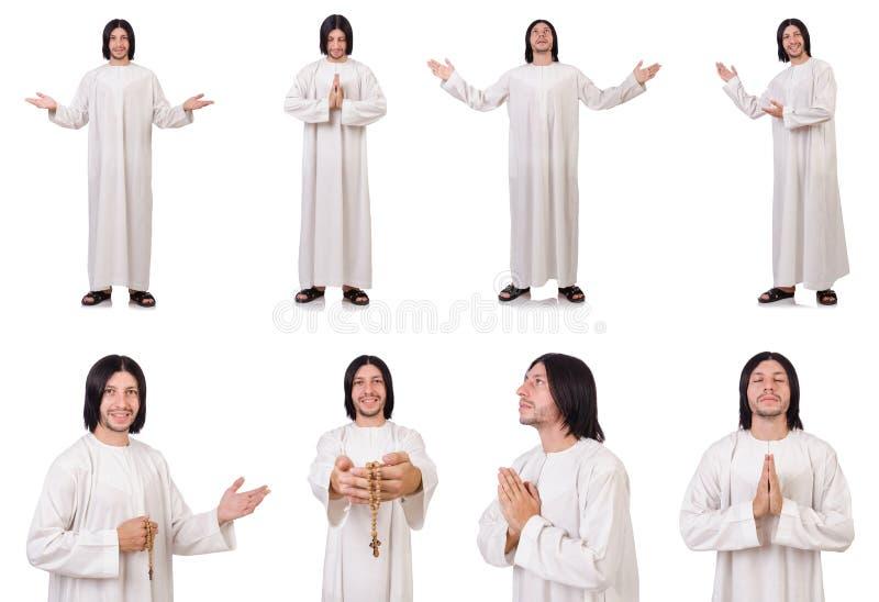 Le jeune prêtre avec la bible d'isolement sur le blanc photographie stock libre de droits