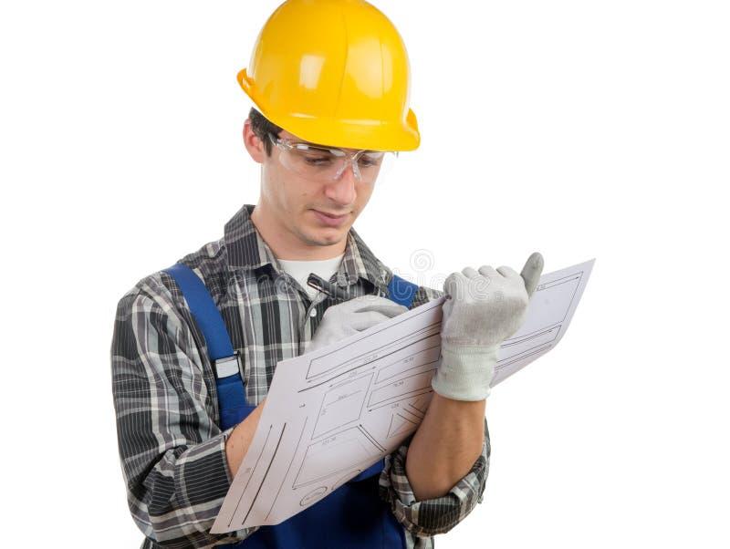Le jeune travailleur écrivent un plan photographie stock libre de droits