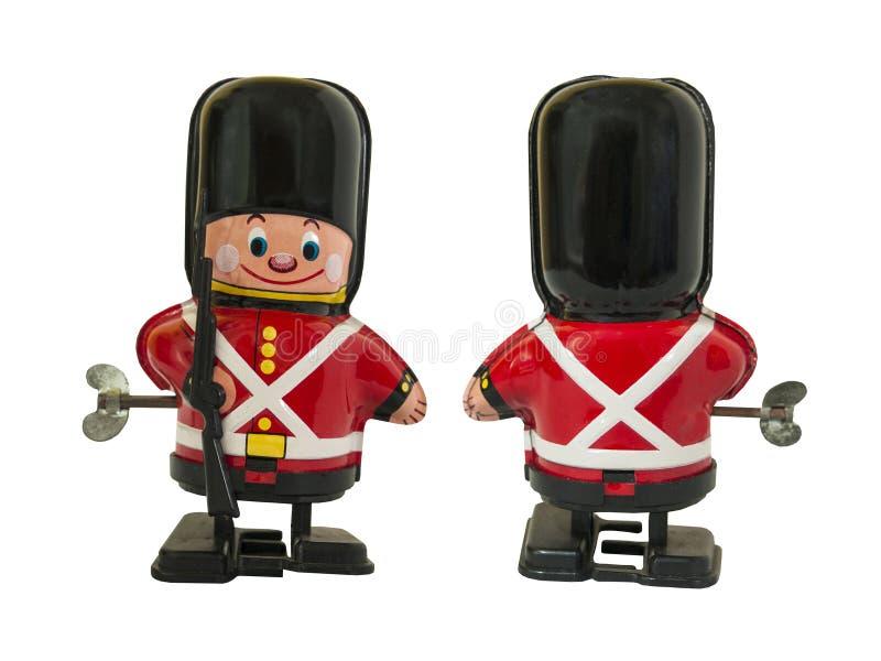 Le jouet de bidon de garde de soldat, enroulent le jouet/blanc d'isolement photographie stock