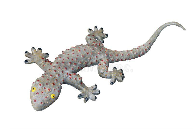 Le jouet de gecko, grand lézard impressionnant de gecko a isolé le fond blanc photo stock