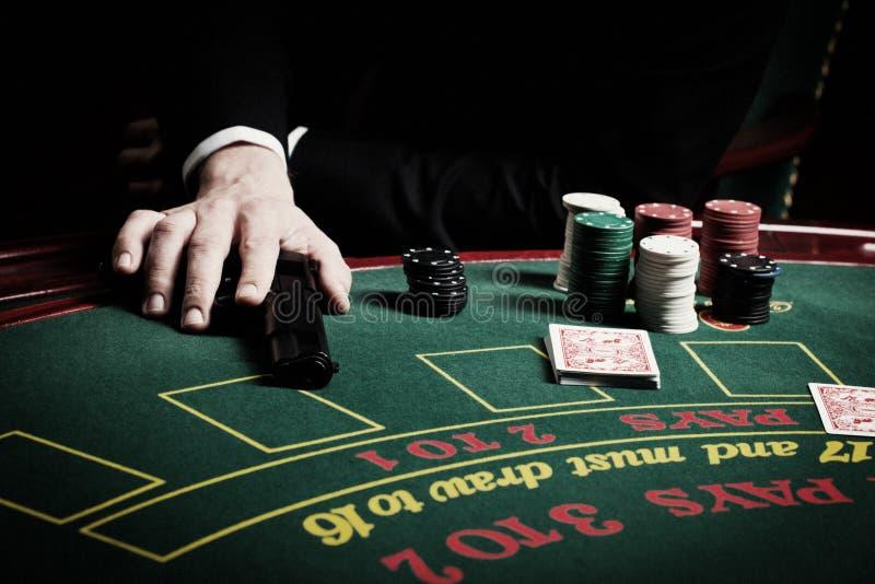 Le joueur dans le casino image stock