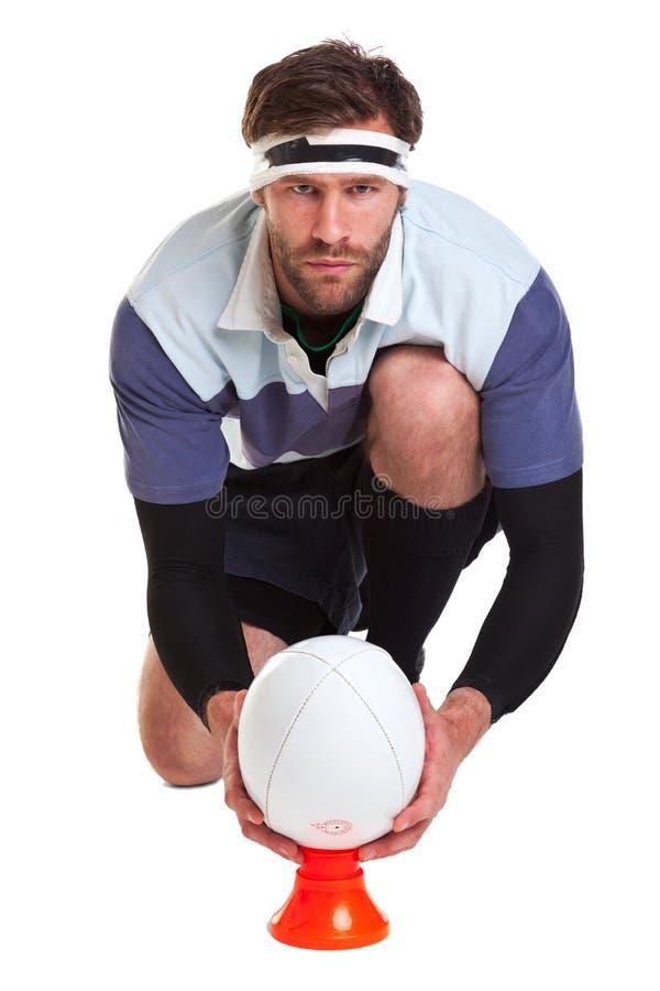 Le joueur de rugby a coupé sur le blanc photo stock