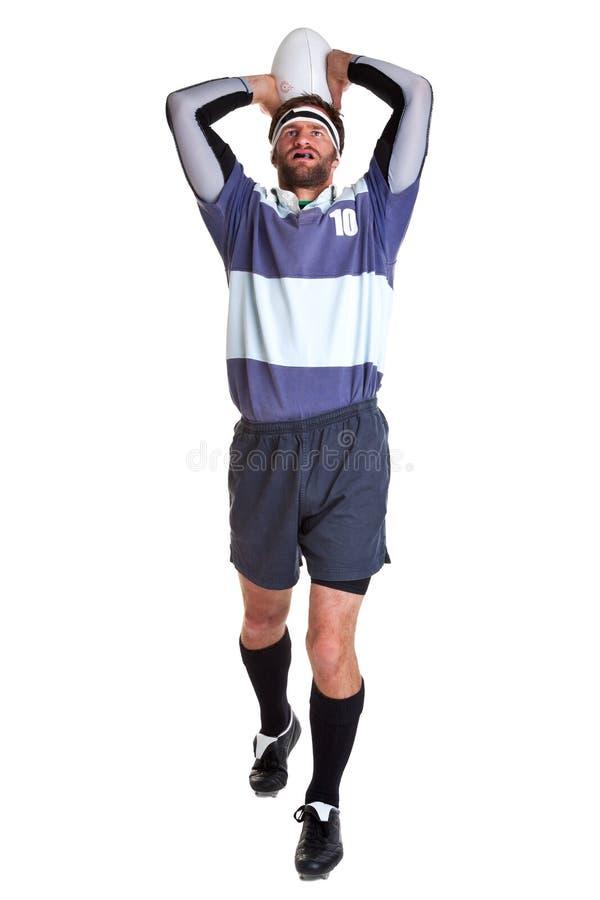 Le joueur de rugby a coupé sur le blanc images stock