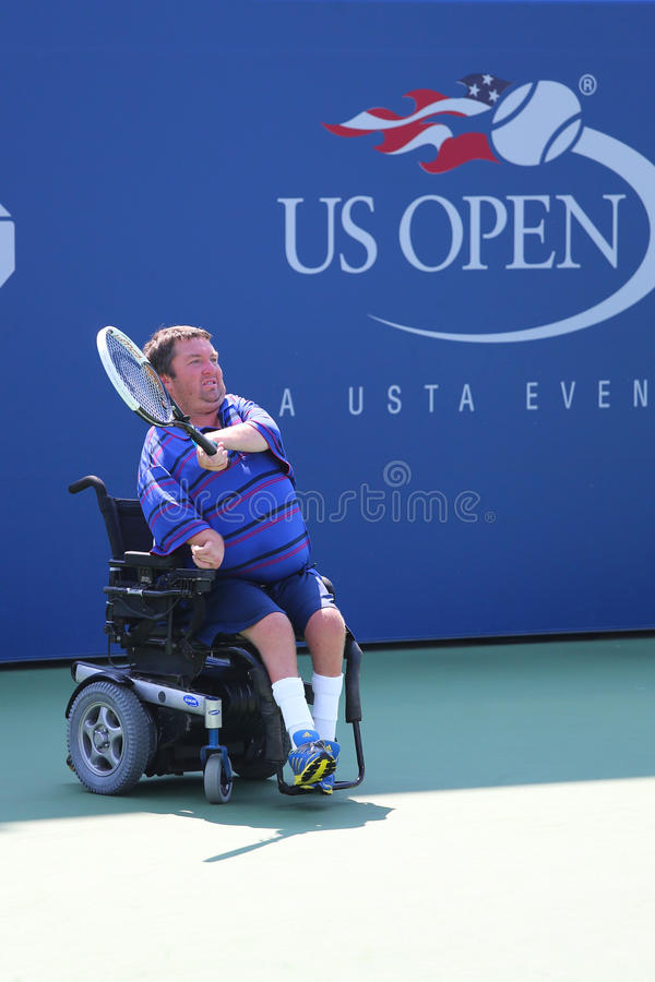 Le joueur de tennis Nicholas Taylor des Etats-Unis pendant le quadruple 2014 de fauteuil roulant d'US Open choisit le match images libres de droits