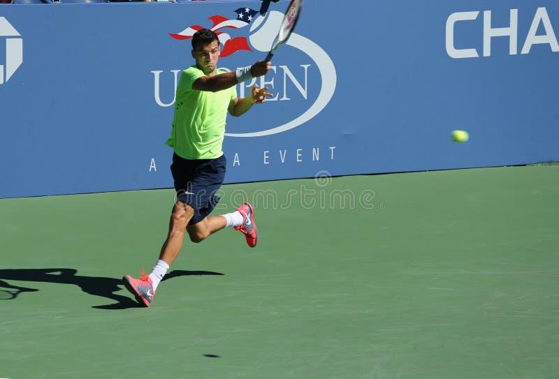 Le joueur de tennis professionnel Grigor Dimitrov de Bulgarie pratique pour l'US Open 2013 chez Billie Jean King National Tennis C images stock