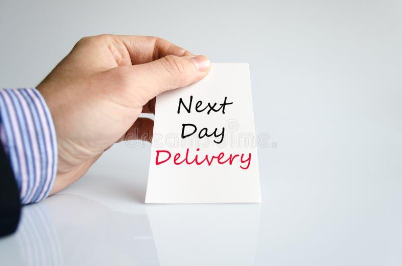 Le jour suivant concept des textes de la livraison images stock