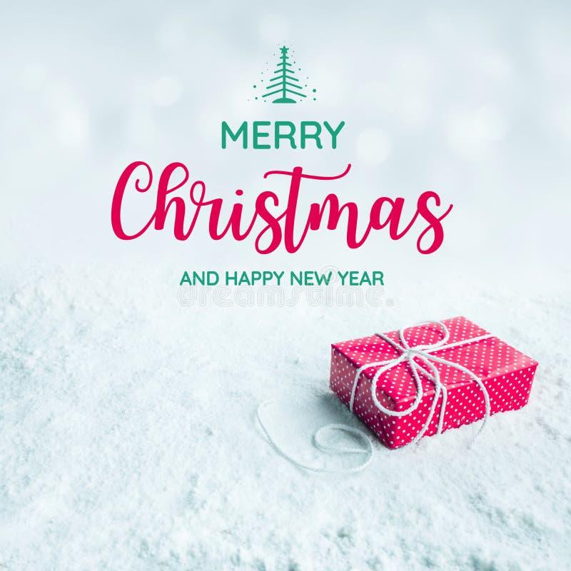 Le Joyeux Noël et la bonne année textotent en présence du boîte-cadeau, image libre de droits