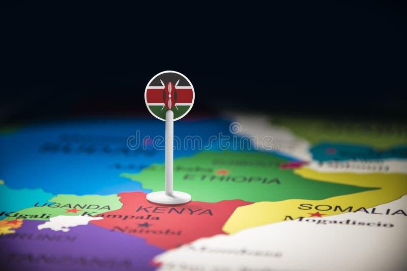 Le Kenya a identifié par un drapeau sur la carte images stock