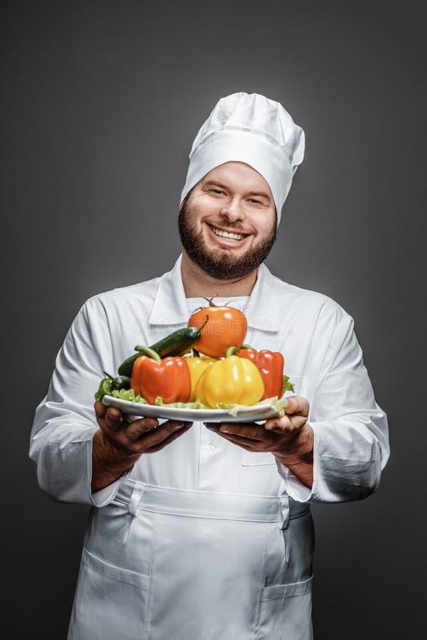 Le kockvisningplattan med grönsaker royaltyfri foto