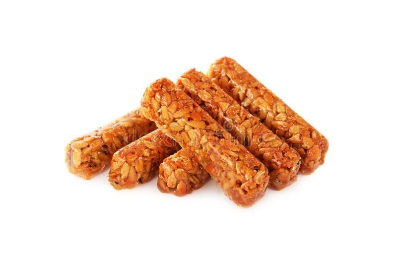 Le kozinaki de bonbons fait à partir des graines de tournesol et le caramel sucrent l'isolant photographie stock libre de droits