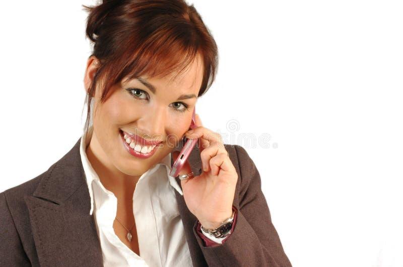le kvinna för affärstelefon arkivbild