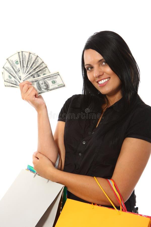 le kvinna för pengarshopping arkivfoto