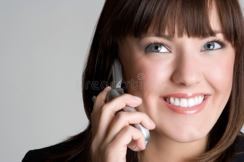 le kvinna för telefon arkivbilder