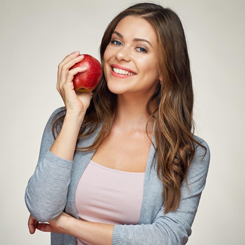 Le kvinnan med det röda äpplet för sund tandholdinh royaltyfri fotografi
