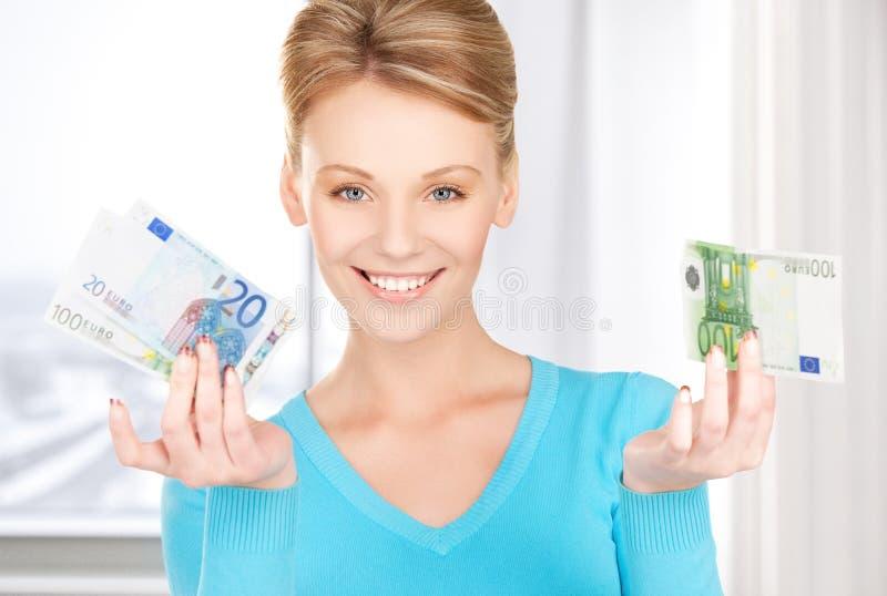 Le kvinnan med pengar royaltyfri bild
