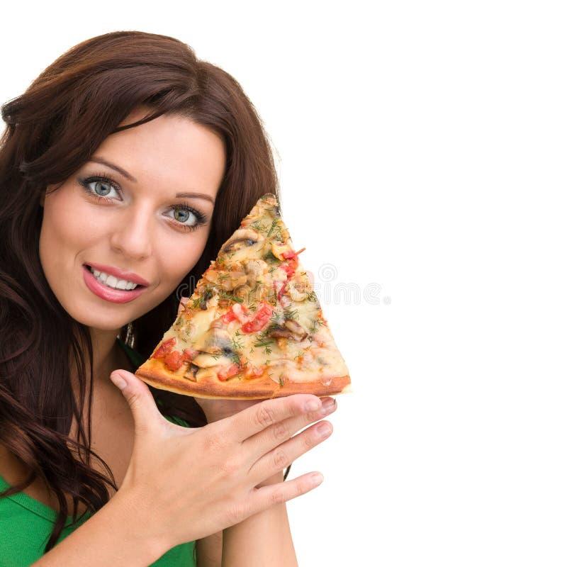 Le kvinnan med stor pizza som isoleras på en vit royaltyfri foto