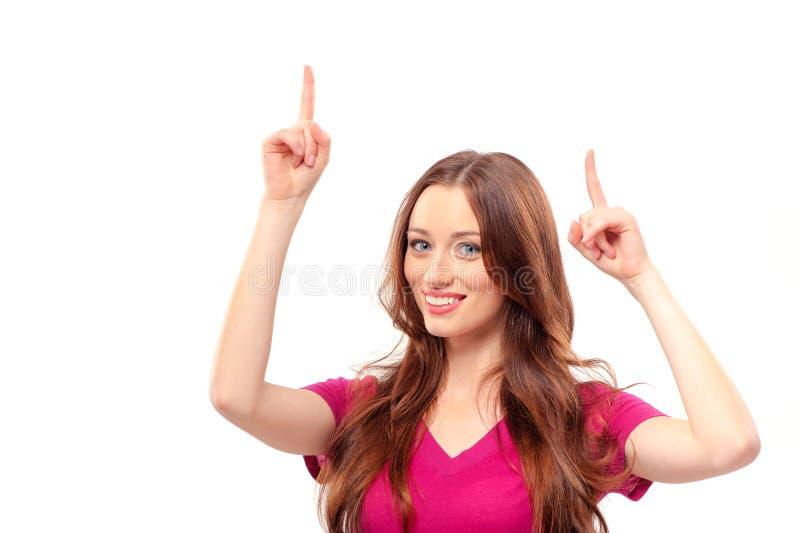 Le kvinnan som pekar upp kopieringsutrymme royaltyfria foton
