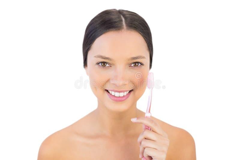 Le kvinnan som rymmer hennes tandborste arkivfoto