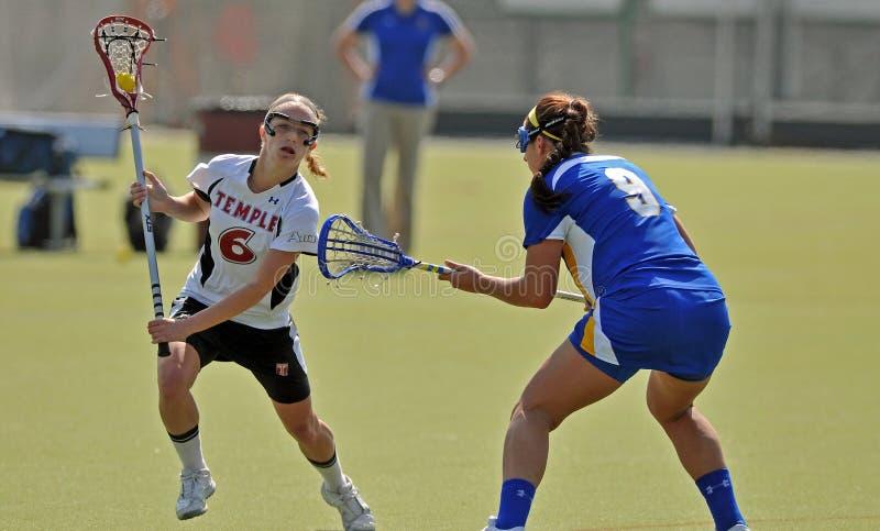 Le Lacrosse des femmes de NCAA (LAX) image libre de droits