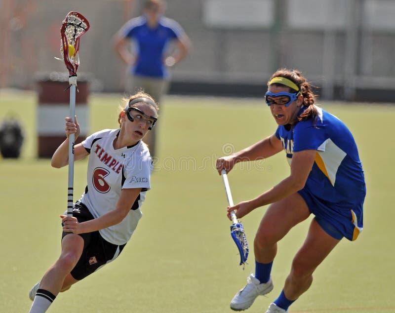 Le Lacrosse des femmes de NCAA (LAX) images libres de droits
