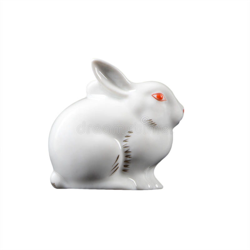 Le lapin de lapin de Pâques, petite statue i de faïence de porcelaine de lièvres images libres de droits