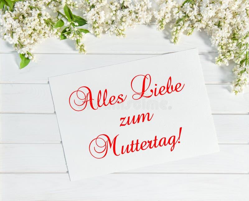 Le lilas fleurit la carte de voeux allemande de jour de mères de Muttertag photo stock