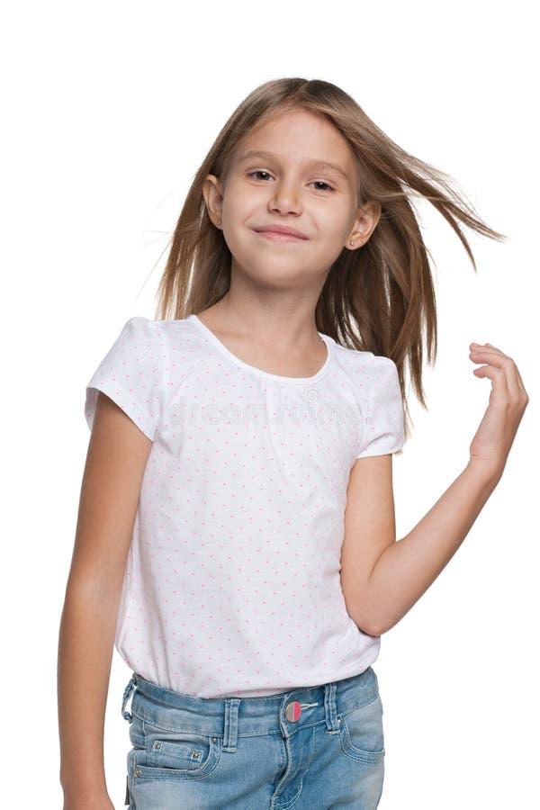 Le lilla flickan med flödande hår fotografering för bildbyråer