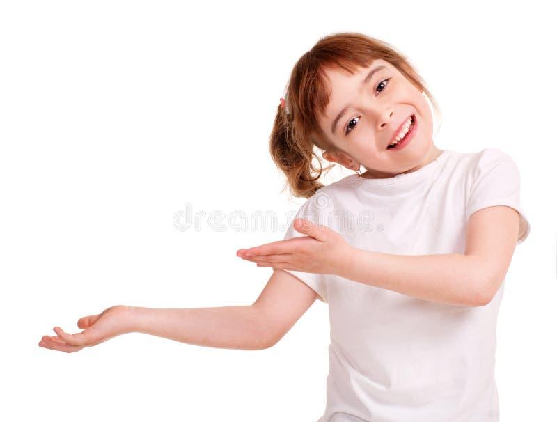 Le lilla flickan som visar den tomma handen arkivfoton