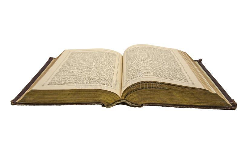 Le livre d'histoire antique ouvert s'est fané fond d'isolement photos stock