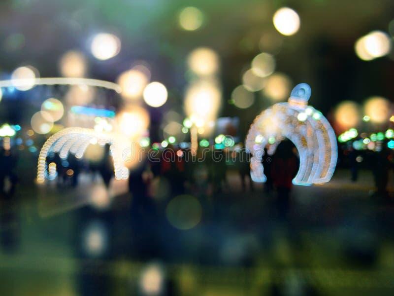 Le luci hanno offuscato il fondo del bokeh Tempo di natale fotografie stock