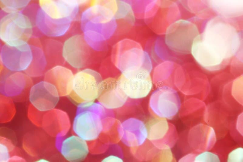 Le luci morbide rosse, rosa, bianche, gialle e del turchese sottraggono il fondo - colori scuri fotografia stock