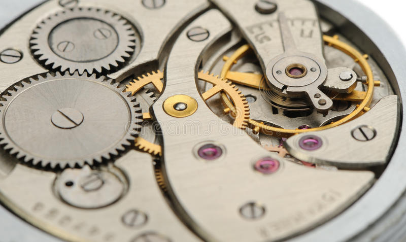 Le mécanisme des heures analogiques images stock