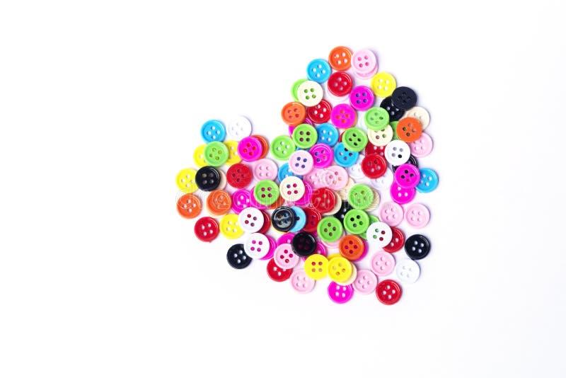 Le mélange de forme de coeur colore des boutons des accessoires a décoré la mode de vêtements photo stock