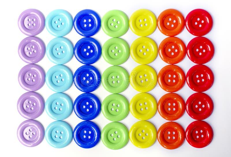 Le mélange de vue supérieure colore boutons de ton d'arc-en-ciel de grands image libre de droits