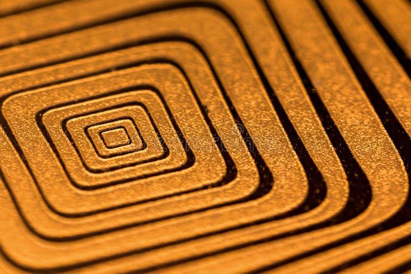 Le métal d'or ondule le fond abstrait carré image stock