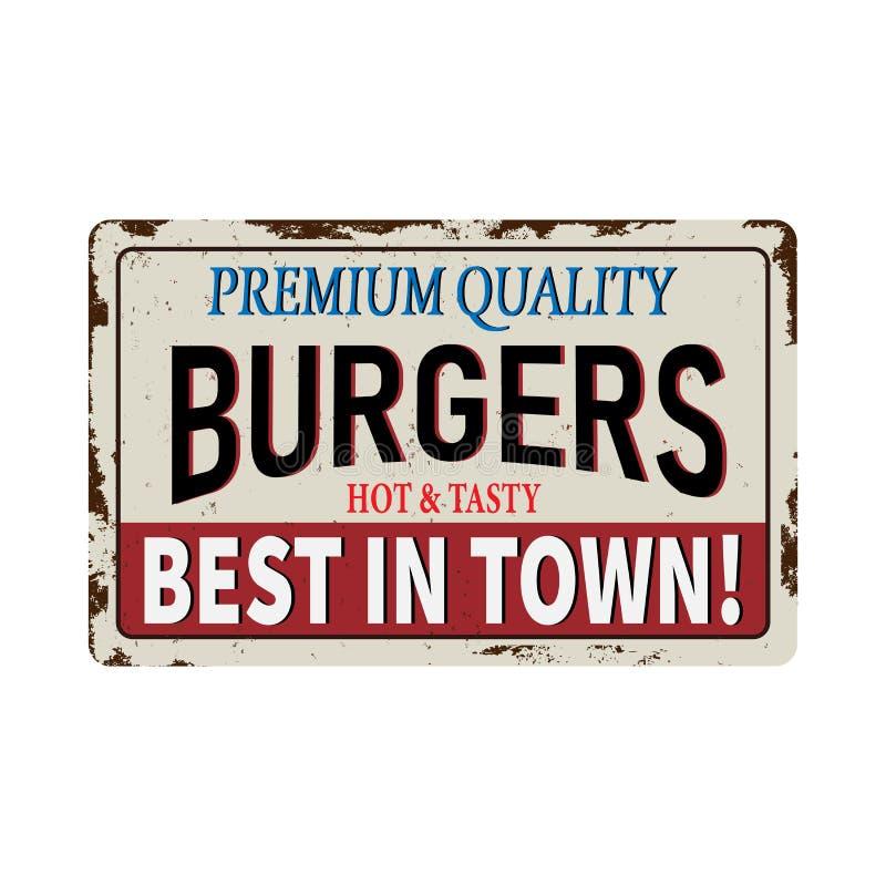 Le métal rouillé de cru d'hamburgers se connectent un fond blanc photo stock