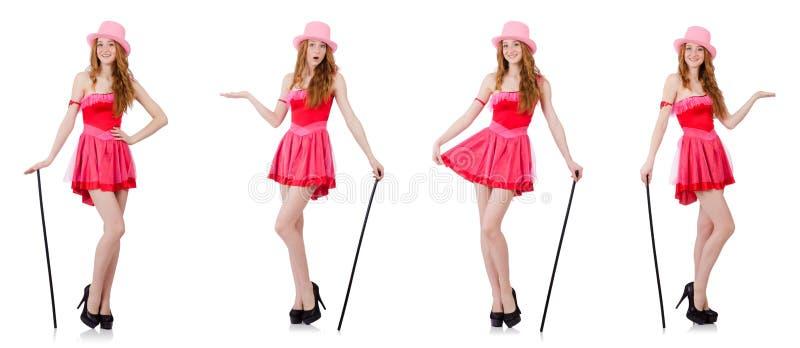 Le magicien assez jeune dans la mini robe rose d'isolement sur le blanc photographie stock