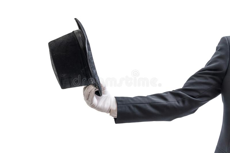 Le magicien ou l'illusionniste montre le chapeau D'isolement sur le fond blanc image libre de droits