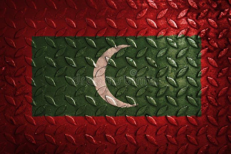 Le Maldive inbandierano, metal la struttura su fondo immagini stock