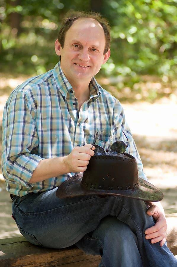 Le man med med cowboyhatten royaltyfri fotografi
