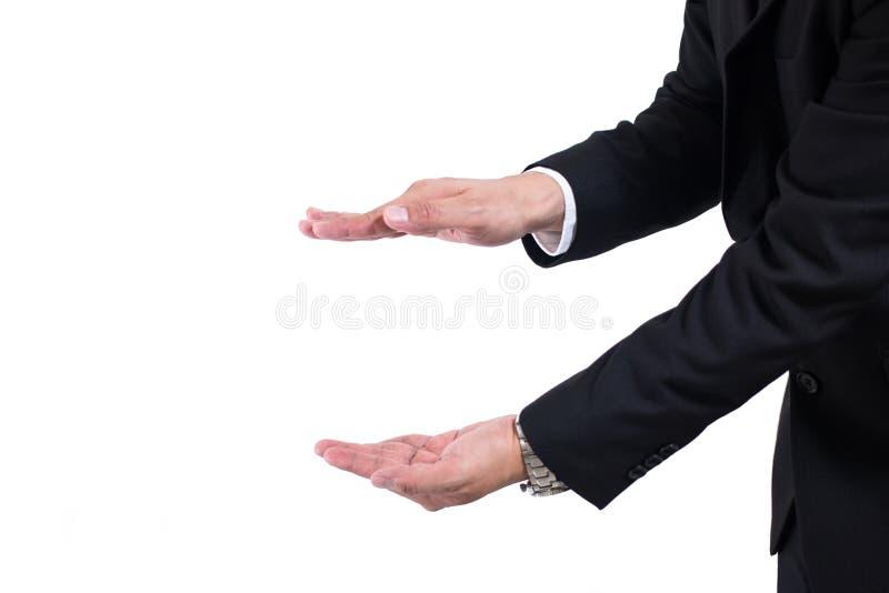 Le mani aprono l'uomo d'affari I vostri oggetti sono qui Uomo d'affari in un vestito nero e legame con la mano tesa immagine stock