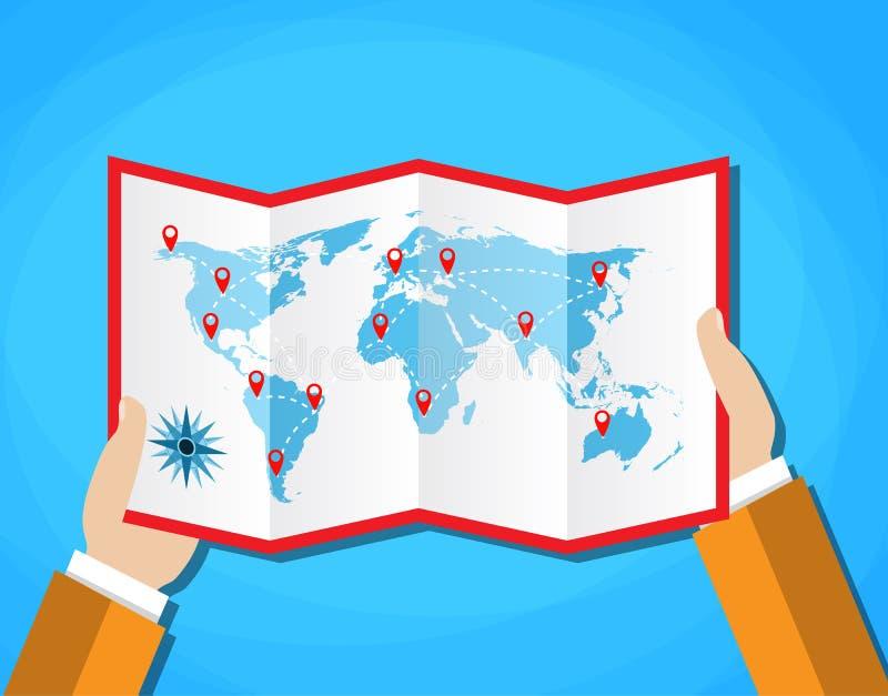 Le mani del fumetto tengono la mappa di carta piegata del mondo con gli indicatori del punto di colore Paesi della mappa di mondo illustrazione di stock
