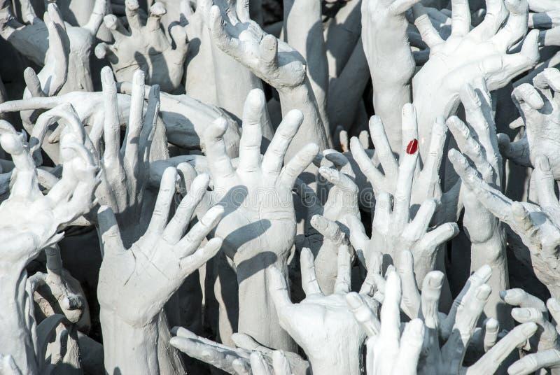 Le mani del peccatore fotografie stock