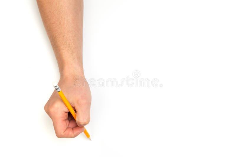 Le mani dell'uomo che scrivono con la matita sul fondo bianco isolato con il posto del testo immagine stock