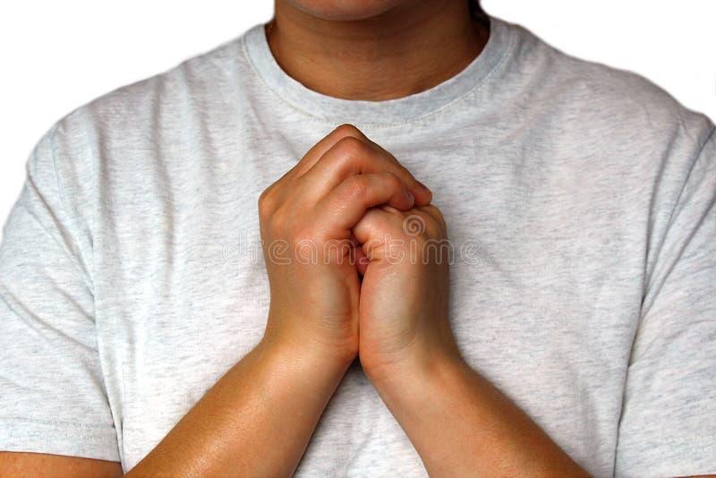 Le mani delle donne hanno piegato davanti voi fotografie stock