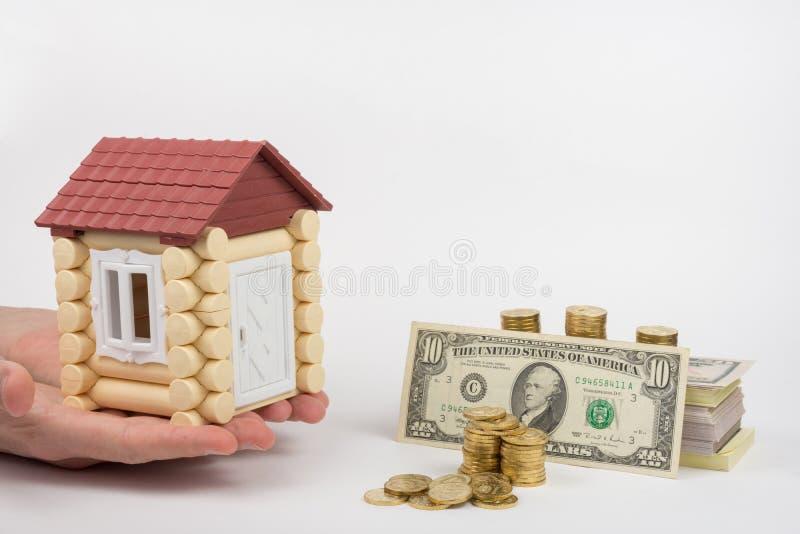 Le mani dovrebbero giocare la casa, bugia seguente USD fotografia stock